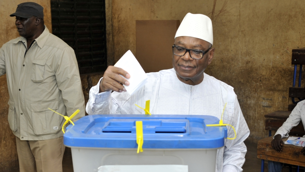 One candidate is kidnapped and ballot boxes torched in elections two years overdue and denounced by the opposition.