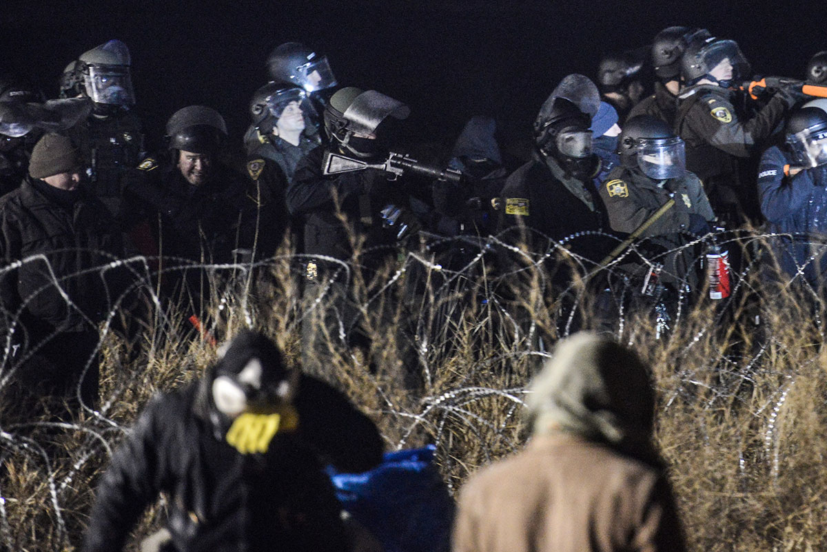 Police confront protesters with rubber bullets during a protest against plans to allow the Dakota Access Pipeline to pass near the Standing Rock Indian Reservation. [Stephanie Keith/Reuters]