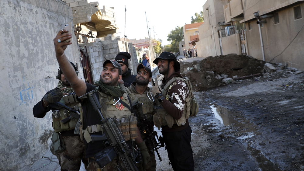 Iraqis advance in Mosul as bomb south of Baghdad kills 21