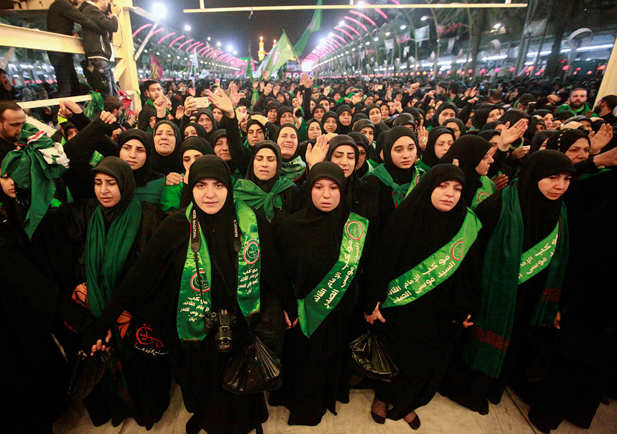 Shia Muslim pilgrims gather as they commemorate Arbaeen, at the shrine of Imam Abbas and the shrine of Imam Hussein, in Karbala, 80km south of Baghdad, Iraq. Millions of Shia Muslims gather each year in Karbala. The holiday marks the end of the 40-day mourning period after the anniversary of the 7th century martyrdom of Imam Hussein, the Prophet Muhammad's grandson. [Alaa Al-Marjani / Reuters]