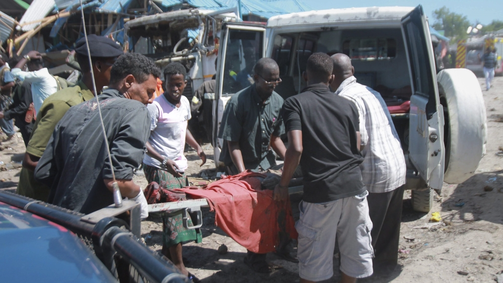 At least 11 people killed in a car bomb attack on a police checkpoint next to a busy market in the Waberi district.