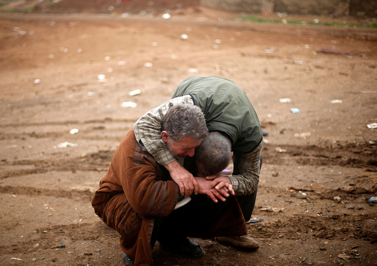 An Iraqi mourns the death of his son, who was killed during clashes in the ISIL stronghold of Mosul. [Mohammed Salem/Reuters]