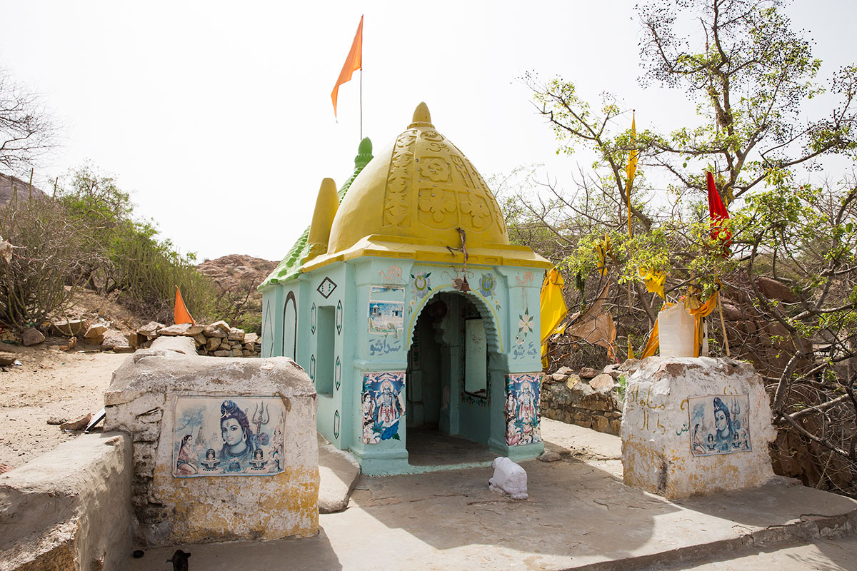 High up in the mountains is a temple frequented by people who come here to pray for rain. At the time of the Shiv festival and the monsoon festival, there is a bustling market here, according to the caretaker. [Faras Ghani/Al Jazeera]