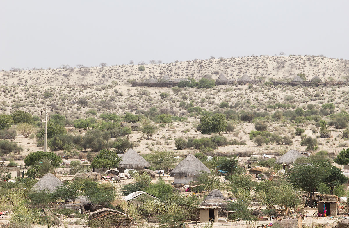 Around 80 percent of Tharparkar is rural and inaccessible by car. Here, people live in chaunras, or straw-roofed mud houses. Most of the villages – 2,300 registered and almost 2,000 unregistered – have no electricity. [Faras Ghani/Al Jazeera]