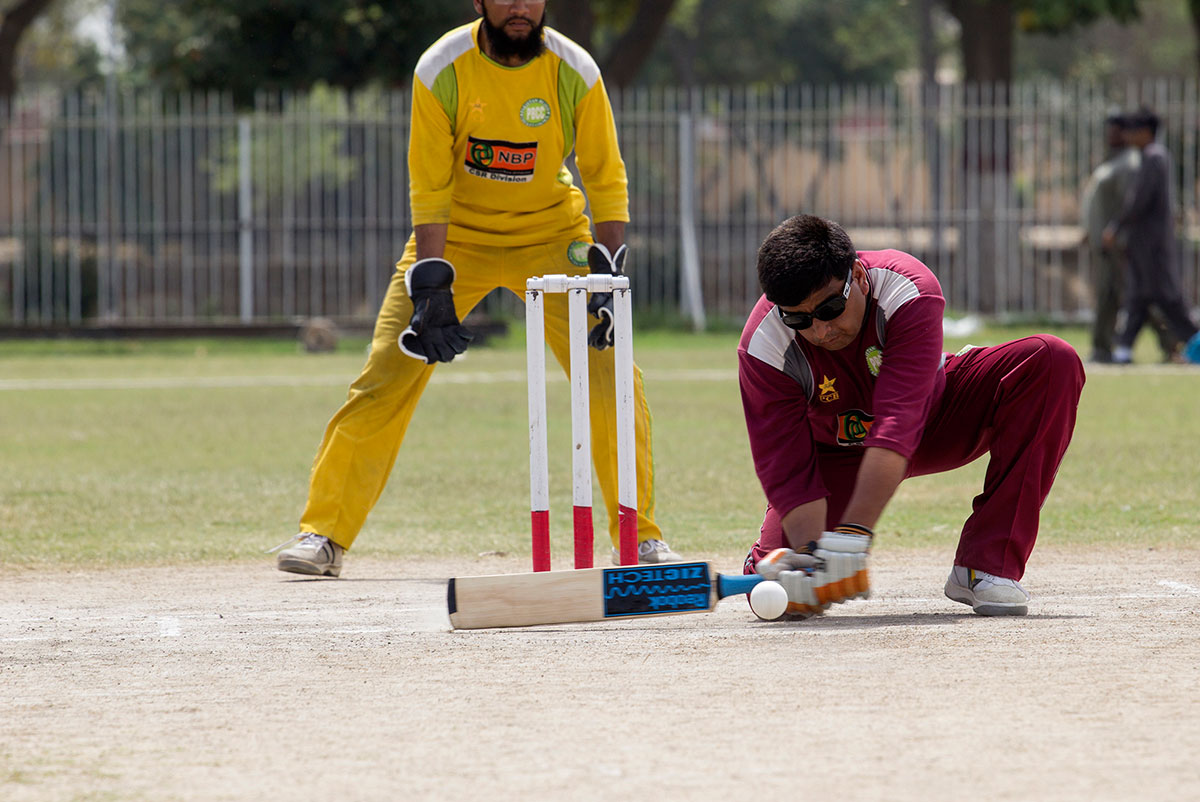 Played on a normal cricket pitch with 11 players on each side, blind cricket has been in action since 1922. But few have followed it or even know it exists. [Faras Ghani/Al Jazeera]