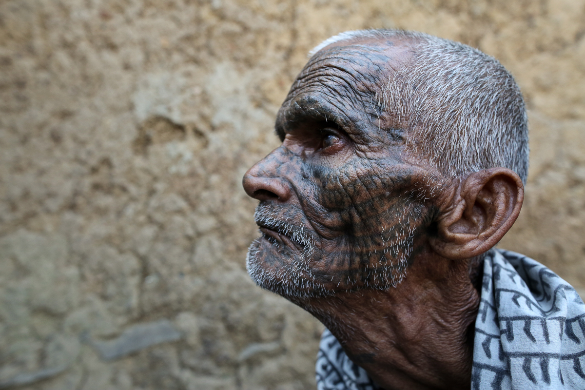 Seventy-one-year-old Ram Nivas from the village of Saras Kela describes how he was first tattooed when he was five years old. 'My father tattooed Ram on my forehead four times,' he says. 'When I turned 30, I tattooed my entire face, arms and legs.' He, in turn, tattooed each of his four children four times when they were young. 'But they did not want their entire body to be covered in tattoos as they work in other states of the country. These tattoos are an obvious sign that the person belongs to the community of untouchables [as Dalits were once known] and my children do not want this,' he explains. 'My grandchildren haven't been tattooed at all.' [Showkat Shafi/Al Jazeera]