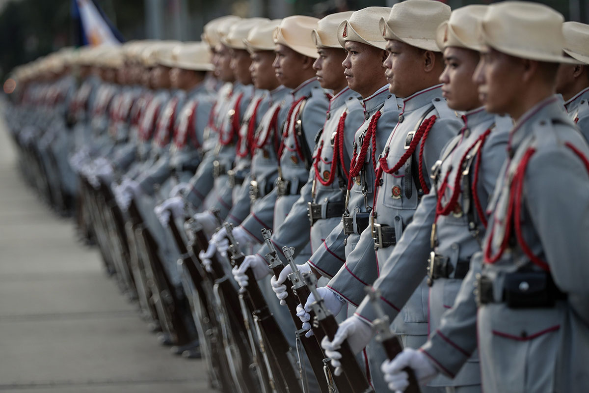 Troops stand guard during a ceremony on the anniversary of the death of national hero Jose Rizal, at the Jose Rizal Park in Manila, Philippines. Filipinos honoured Rizal, whose death by firing squad on December 30, 1896, helped to inspire a Philippine revolution for independence against Spanish occupation. [Mark R Cristino/EPA]