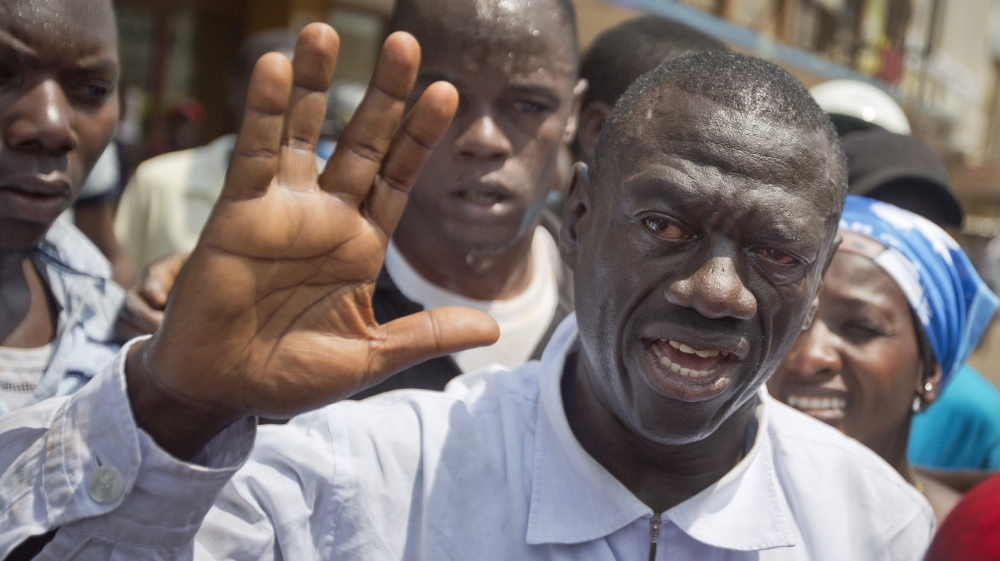 Police briefly detain Kizza Besigye days before presidential vote, prompting Kampala crowds to come out in support.