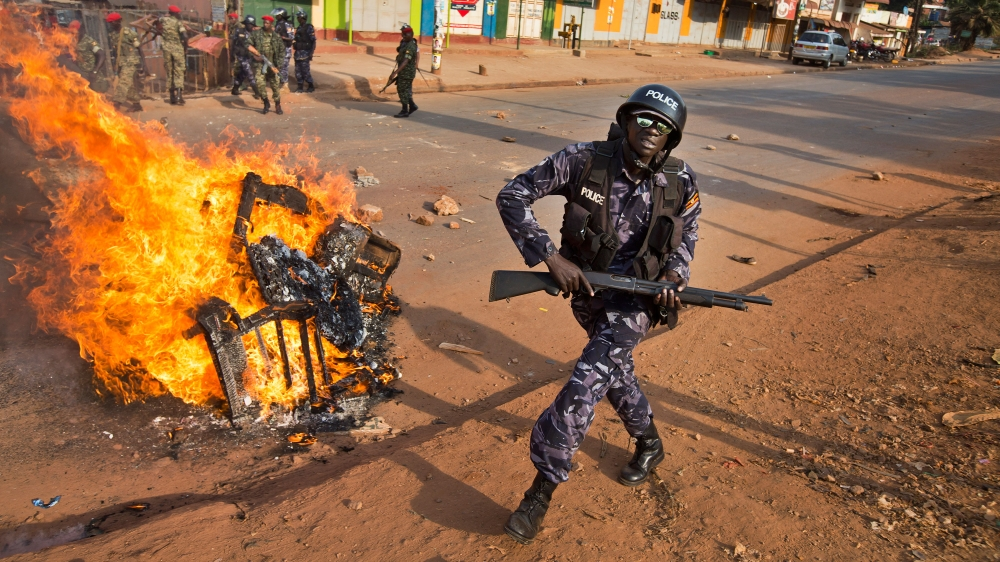 Police clash with opposition supporters in capital Kampala before presidential elections on February 18.