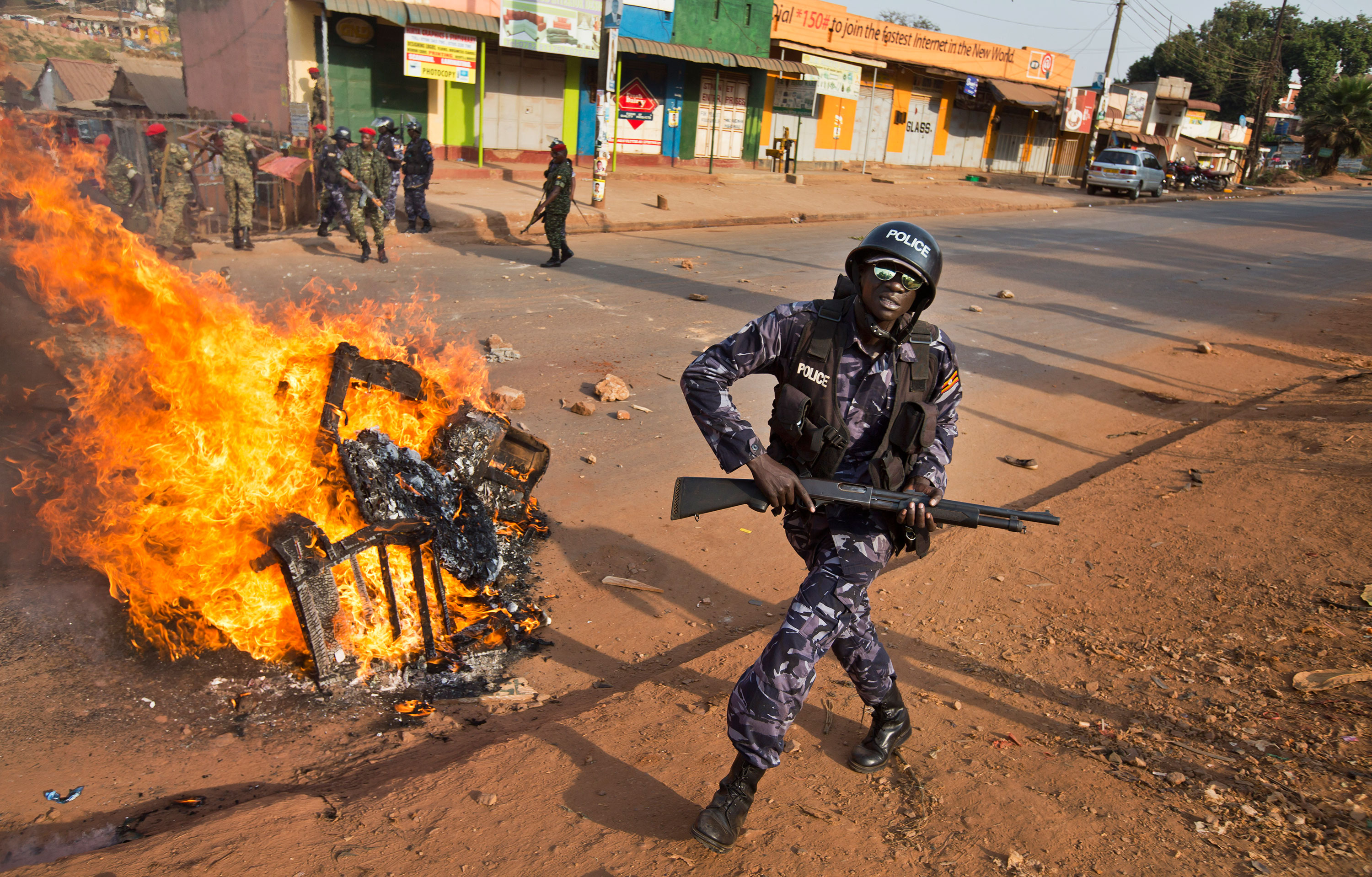 Police spokesman Fred Enanga confirmed on Tuesday that one civilian was killed in the scuffles and that police fired tear gas and rubber bullets to disperse crowds. [Ben Curtis/AP]