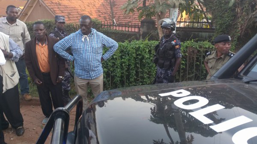 Kizza Besigya arrested by police just before the end of the voting, which President Museveni is expected to win.