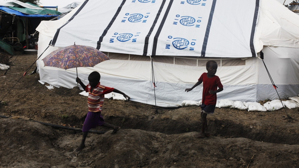 At least 18 people, including two NGO workers, killed at camp offering shelter to civilians fleeing unrest.