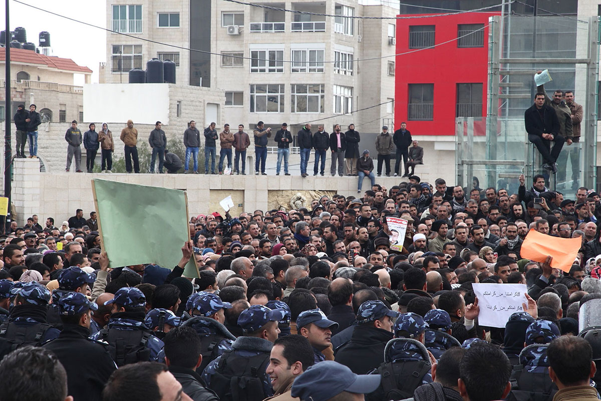 An estimated 10,000 people participated in Tuesday's mass demonstration supporting the strike of Palestinian teachers in government schools. [Rich Wiles/Al Jazeera]