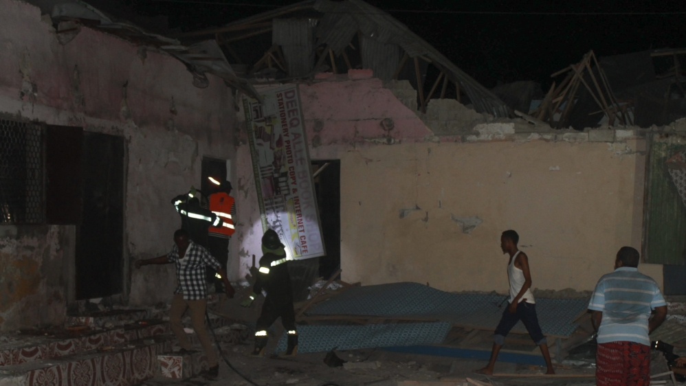 At least nine killed and dozens wounded after fighters set off car bomb near hotel entrance in the capital Mogadishu.