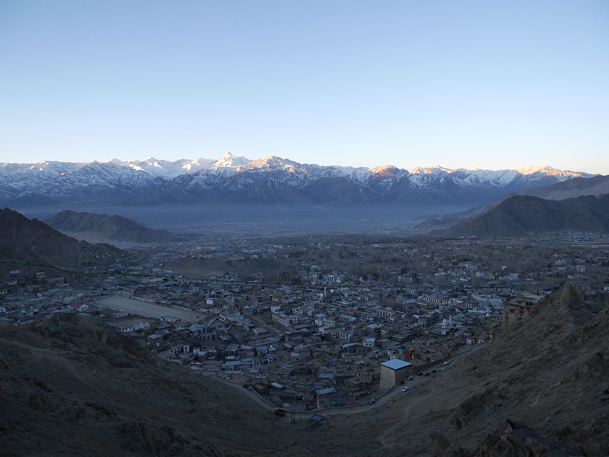 The sun rises over the Himalayas behind the town of Leh, in Ladakh. The remote community lies at a head-spinning altitude of 3,500 metres along India's border with Tibet. People here are renowned for their obsession with ice hockey. [Karishma Vyas/Al Jazeera]