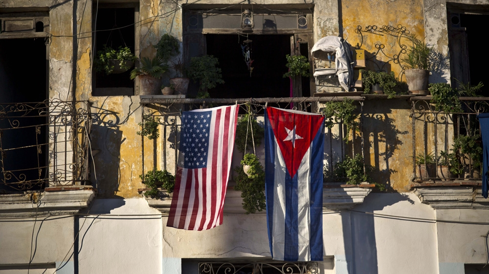 A Us And Cuban Flag Hang From The Same Balcony In Old Havana Cuba Ap Photo Ramon Espinosa