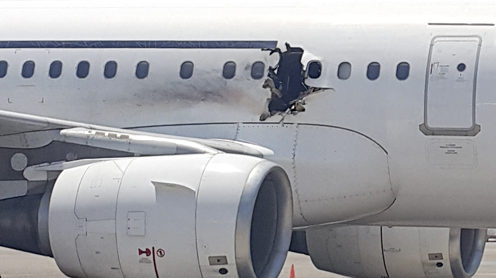 Somali aviation minister says one-metre-sized hole in the side of Daallo Airlines jet was caused by a bomb explosion.