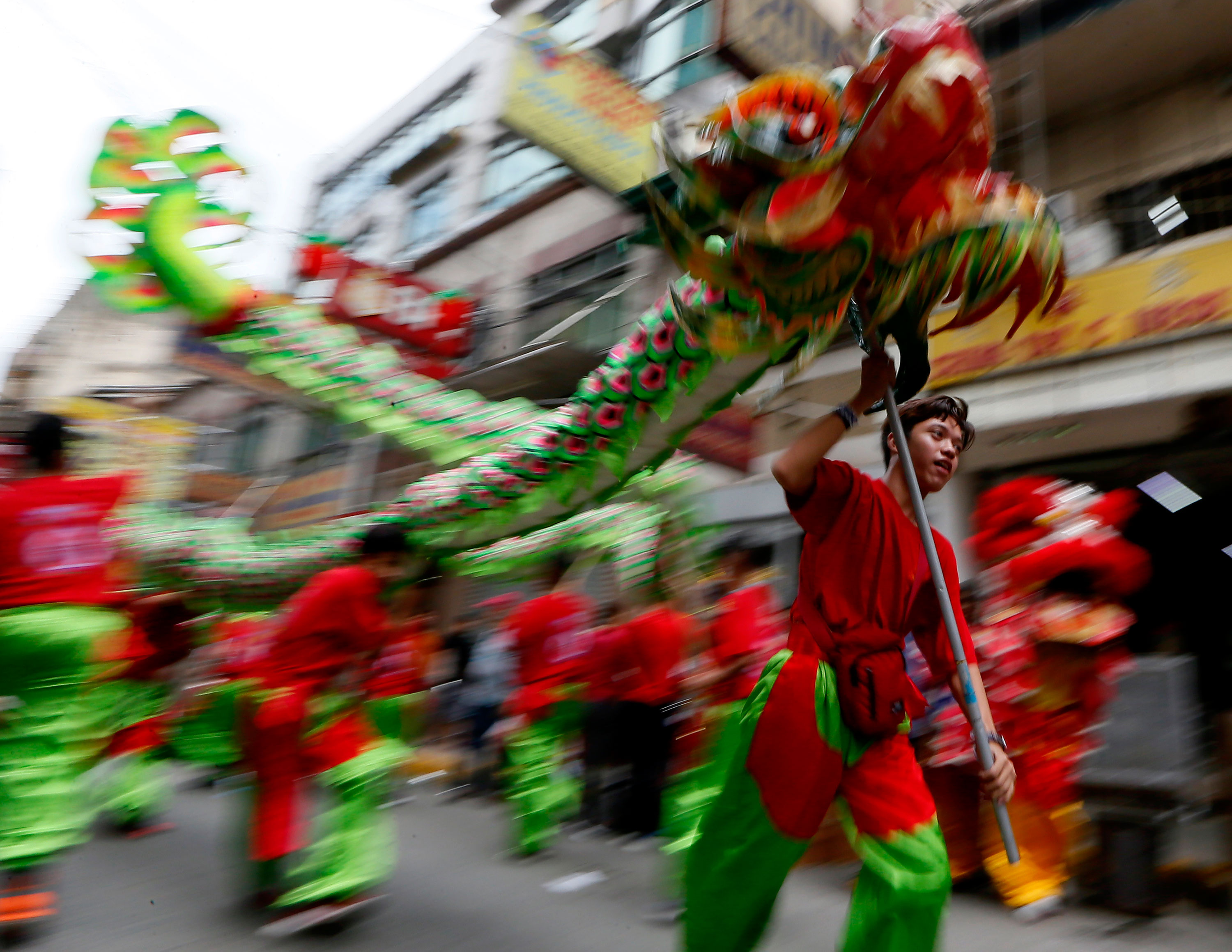 fireworks and dragon dances usher in year of the monkey al jazeera