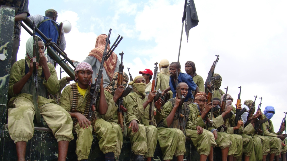 Senior commander makes public appearance to deny claims he and another leader were killed in raids in southern Somalia.