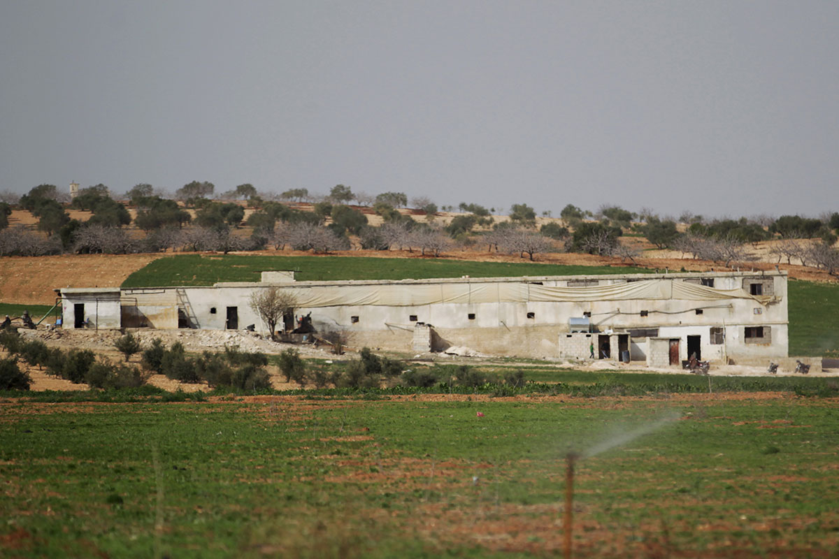 The Freedom School, a converted poultry farm, is in the Syrian town of al-Tamanah, in the southern countryside of Idlib. [Khalil Ashawi/Reuters]