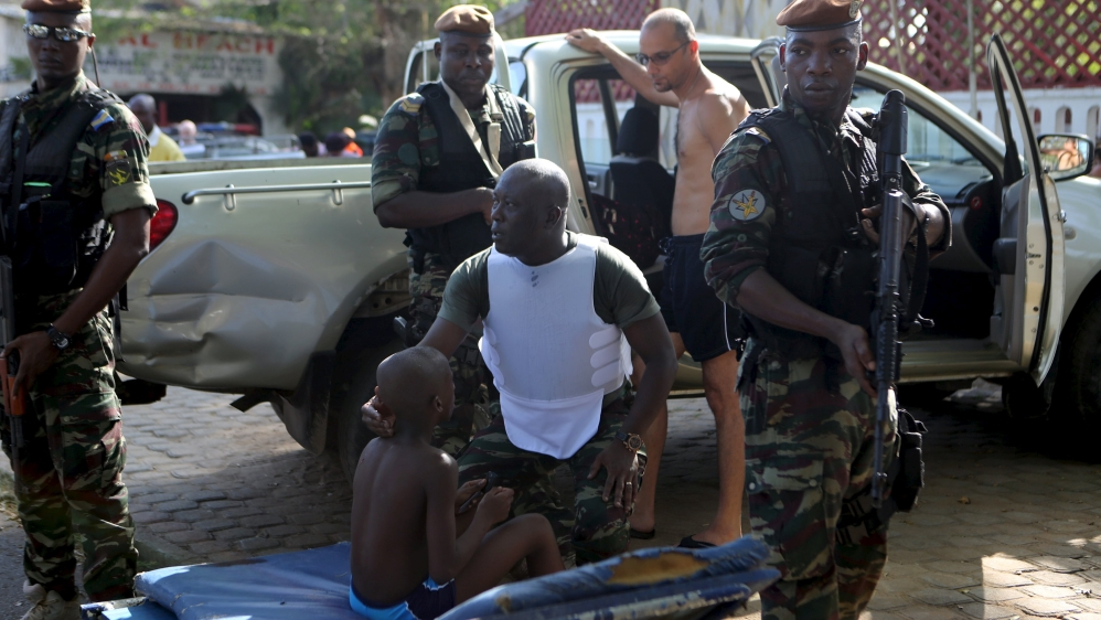 At least 16 people, including four Europeans, dead after six armed men target Grand Bassam beach town, officials say.