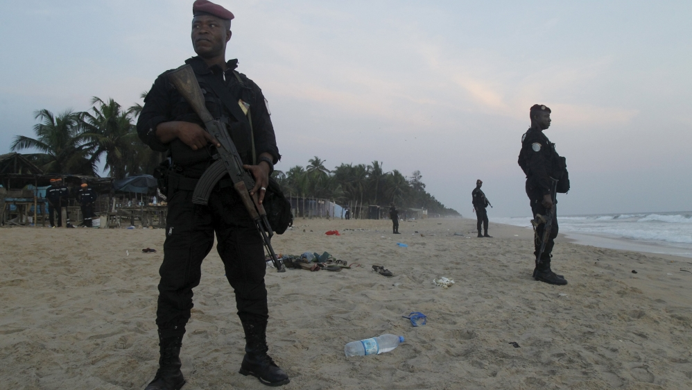 Six gunmen storm Grand Bassam beach town, killing at least 16 people before security forces shoot them dead.