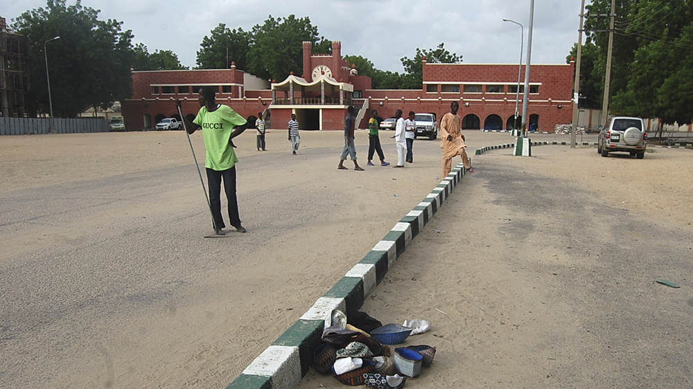 Two suspected female attackers blow themselves up inside and outside a busy mosque in northeastern Maiduguri city.