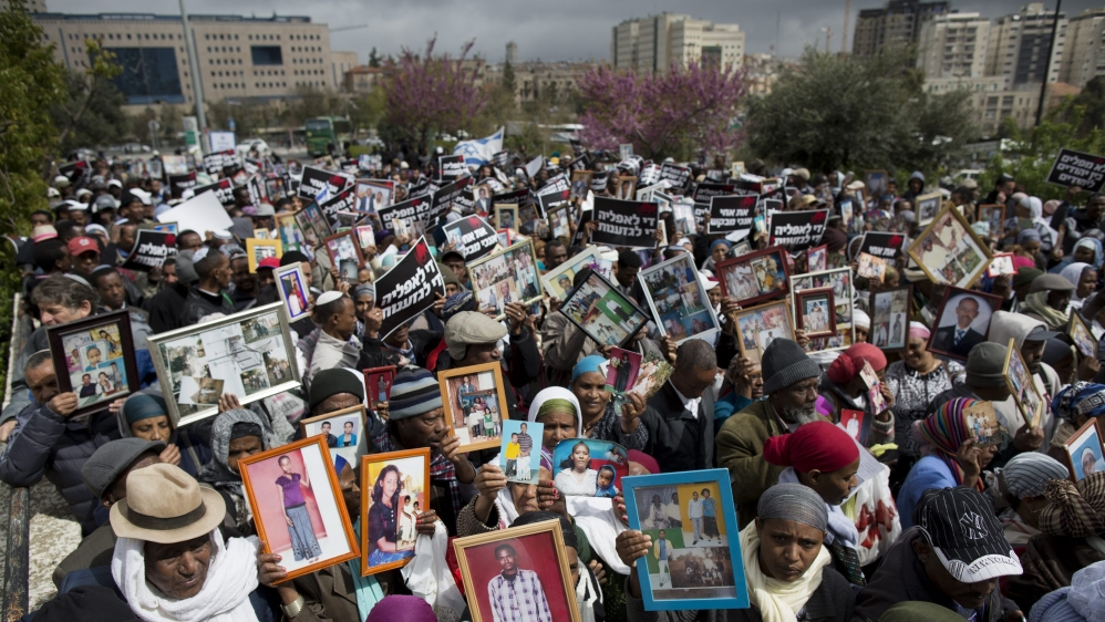 Decision to scrap scheme that would reunite families of Ethiopian Israelis amounts to racism, protesters say.