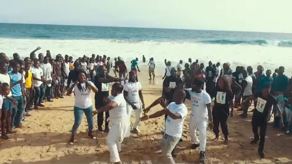 Collective of musicians from Ivory Coast film video on Grand-Bassam beach, the site of attack that killed 19 in March.