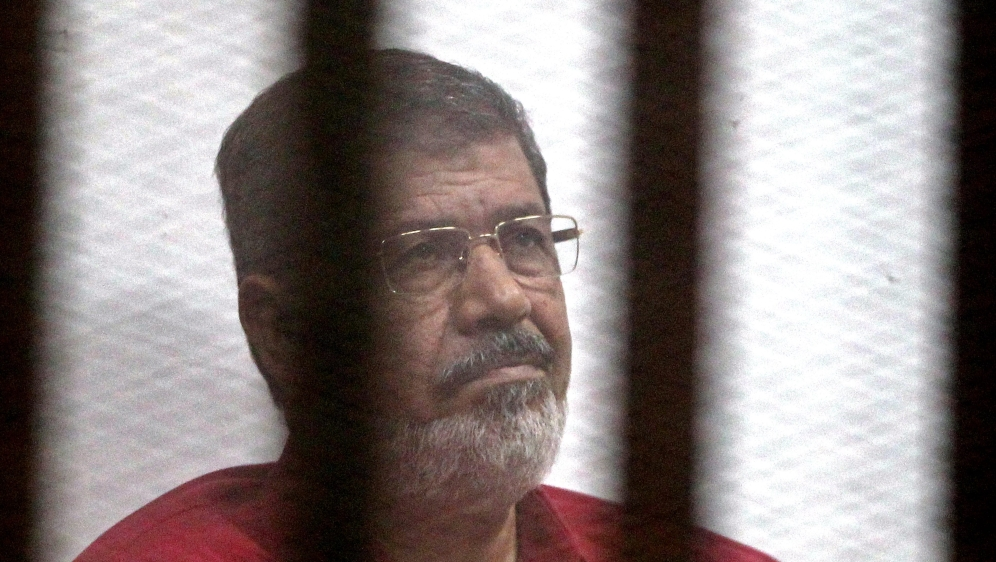 Supreme Judicial Council forces 32 judges into retirement for having opposed the army's ouster of Mohamed Morsi in 2013.