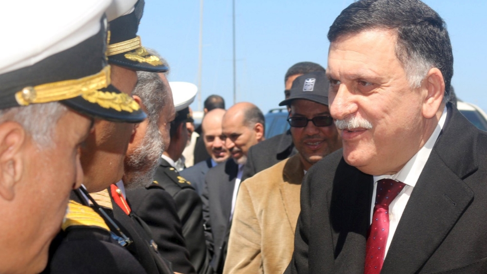Members of Presidential Council arrive in Libyan capital by sea, defying opposition warnings to not move there.