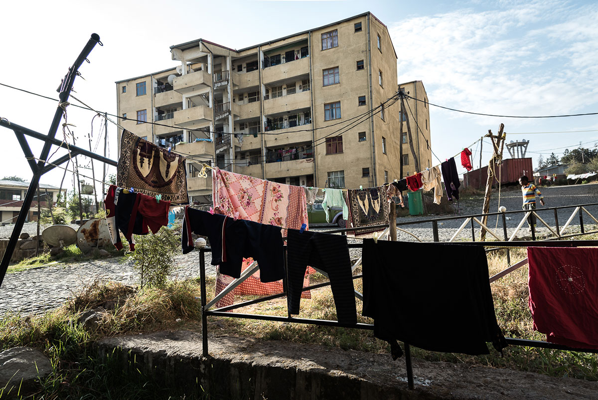 Many Eritrean refugees live in the suburb of Mebra Hailt in Ethiopia's Addis Ababa. Four to eight people live in two-room apartments, paying $150 per month. The average pay for manual labour as a bricklayer, for example, is around $60 per month. [Stefania Prandi/Al Jazeera]