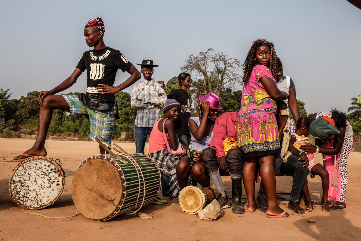 Members of the Iris Carnival group in Bissau wait while their team mates prepare to practise their dance for the big party. [Ricci Shryock/Al Jazeera]