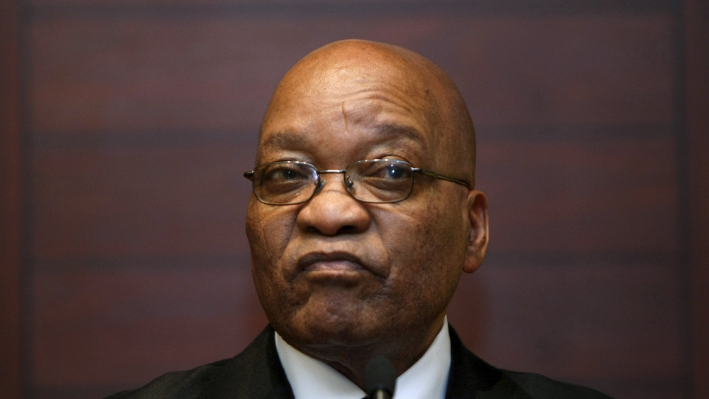 South Africa's High Court calls for review of 2009 decision to drop 783 corruption charges against the president.