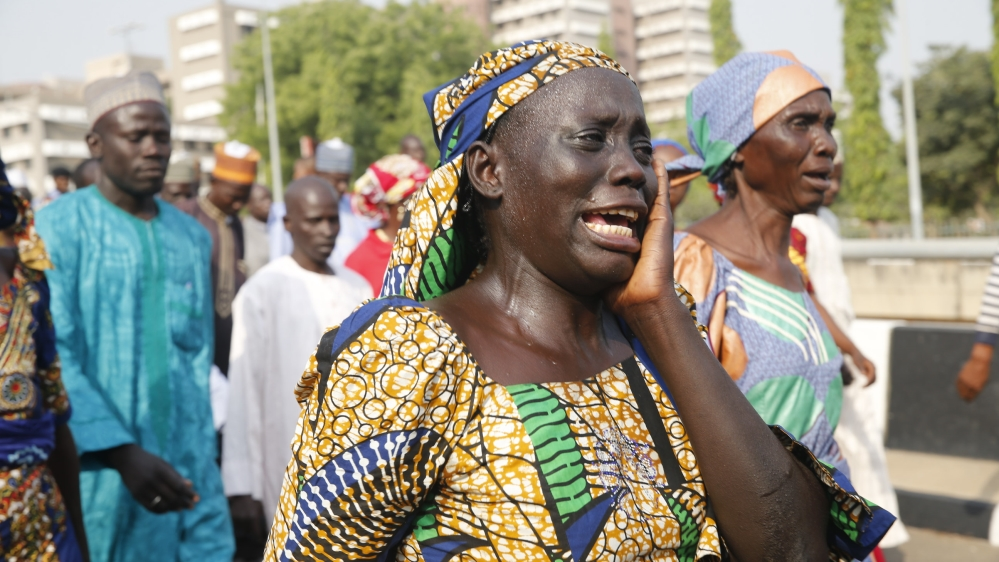 About 15 girls seen in video obtained by government two years after almost 300 of them were kidnapped by Boko Haram.