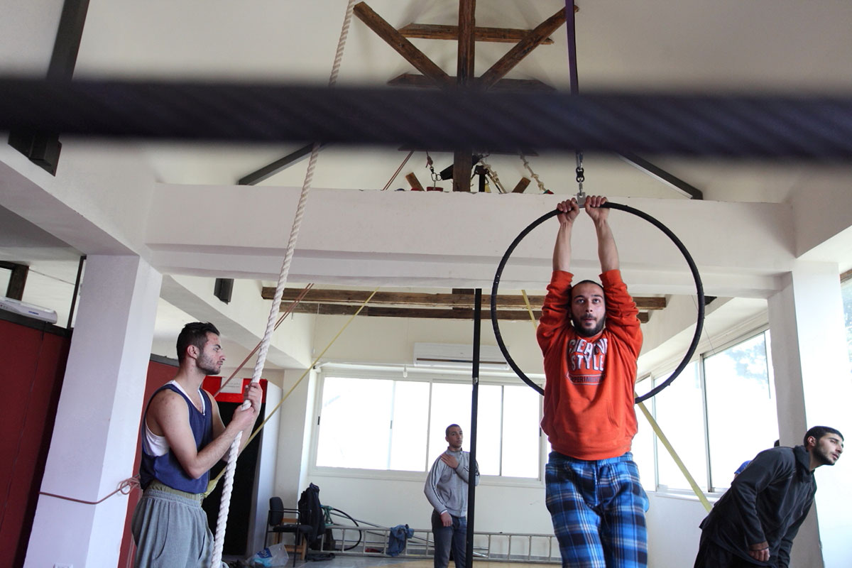 Mohammed Abu Sakha, pictured in orange before his arrest, has been a performer and trainer with the Palestinian Circus School since 2011. [Rich Wiles/Al Jazeera]