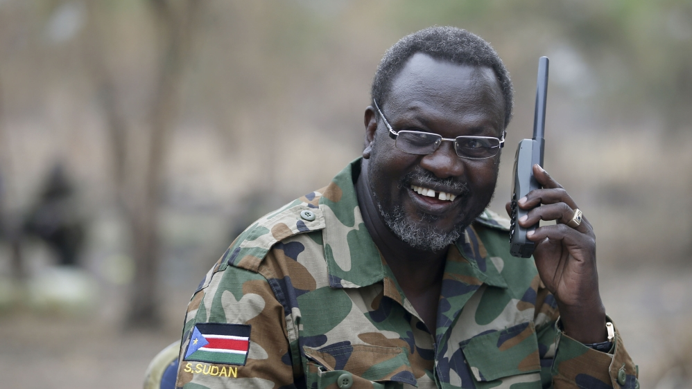 Disagreement over weapons is preventing rebel leader from returning to Juba to form unity government, officials say.