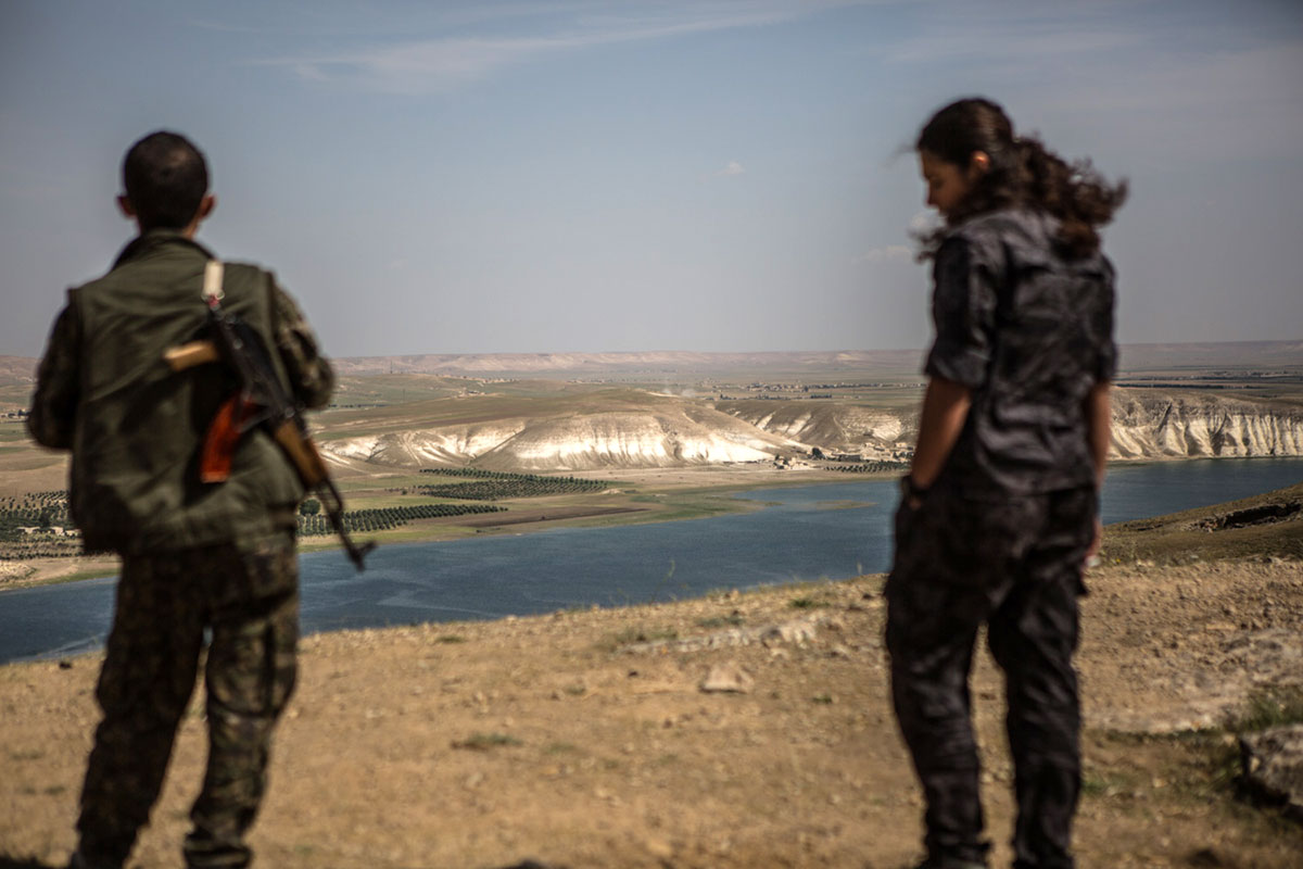 Members of the Syrian Democratic Forces, an umbrella group that includes Kurdish, Arab and Turkmen fighters, watch over the Tishrin Dam. [Mauricio Morales/Al Jazeera]