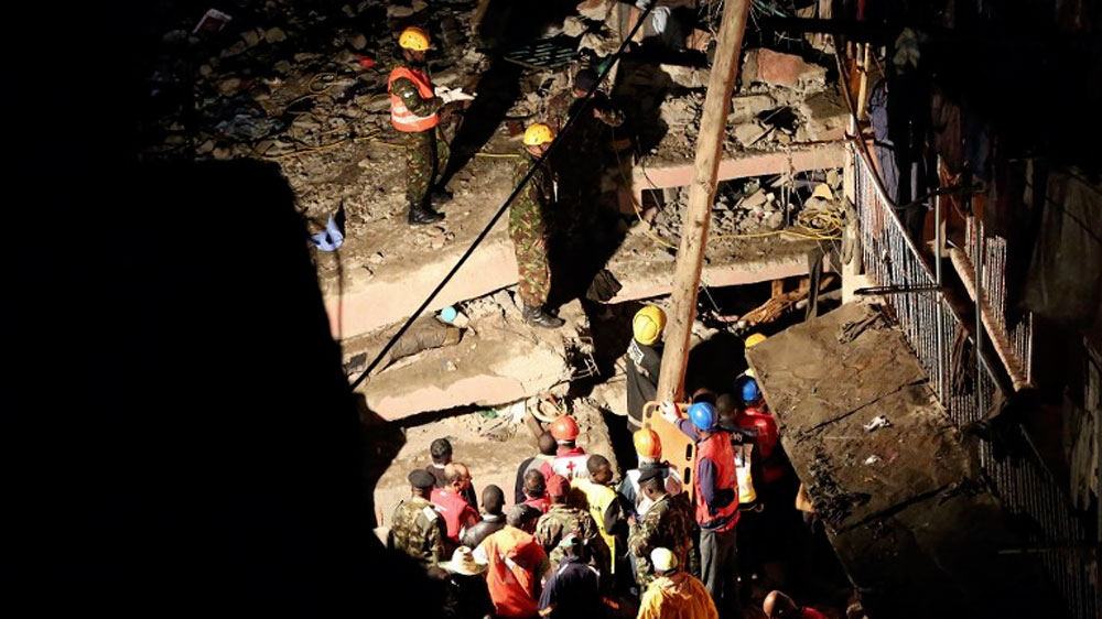 Child rescued 10 hours after apartment block collapsed in torrential rain, killing at least seven people.