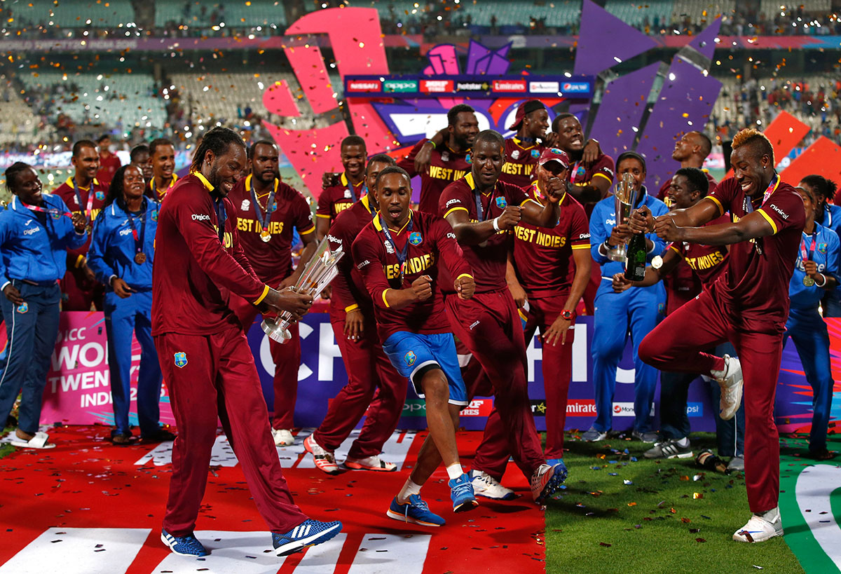 West Indies players celebrate with the trophy after winning the final of the World Twenty20 cricket tournament in Kolkata, India. West Indies won the trophy in a dramatic four-wicket win over England on April 3, 2016. [Adnan Abidi/Reuters]