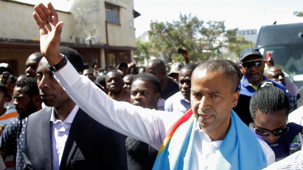 Thousands of supporters protest at accusations that opposition candidate Moise Katumbi was plotting a coup.