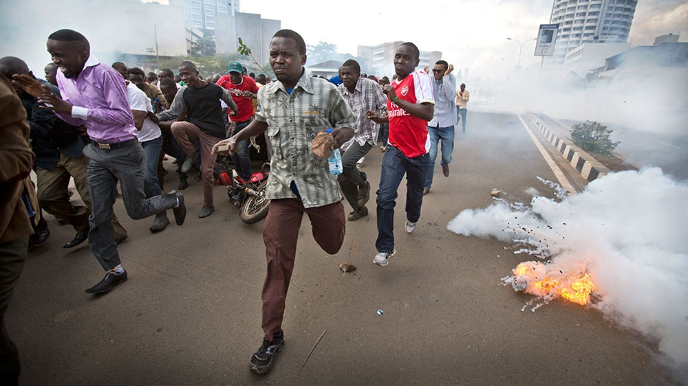 Stone-throwing protesters hit with tear gas and water cannon as tensions rise before next year's election.