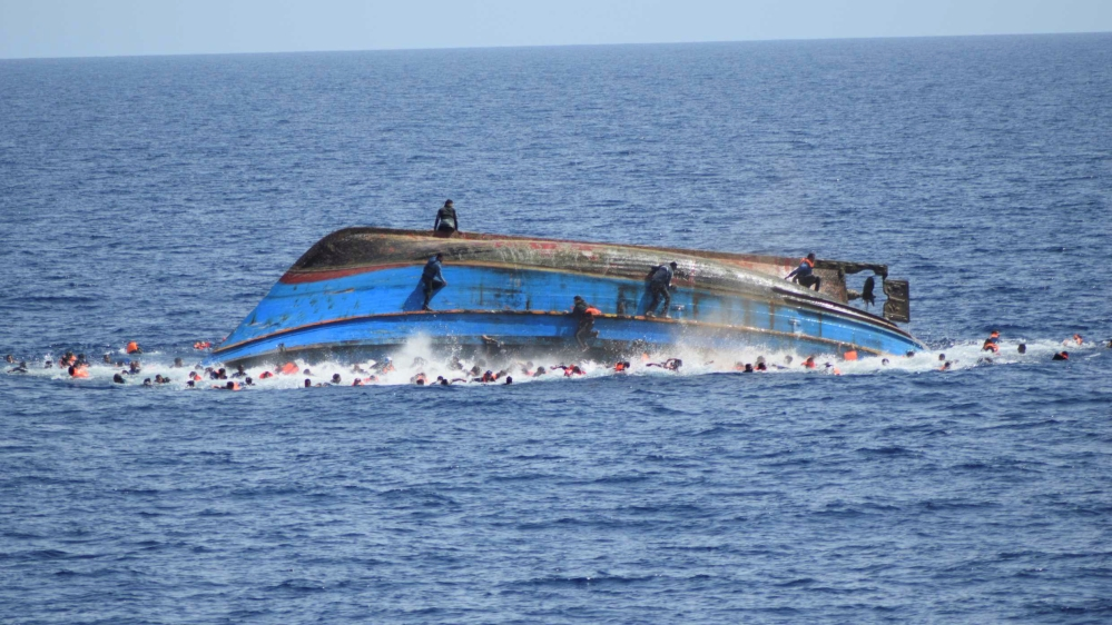 Two refugee boats capsize in 24 hours off libya coast news al waters around the boat filled with people trying to get away from the vessel reutershandout gumiabroncs Images