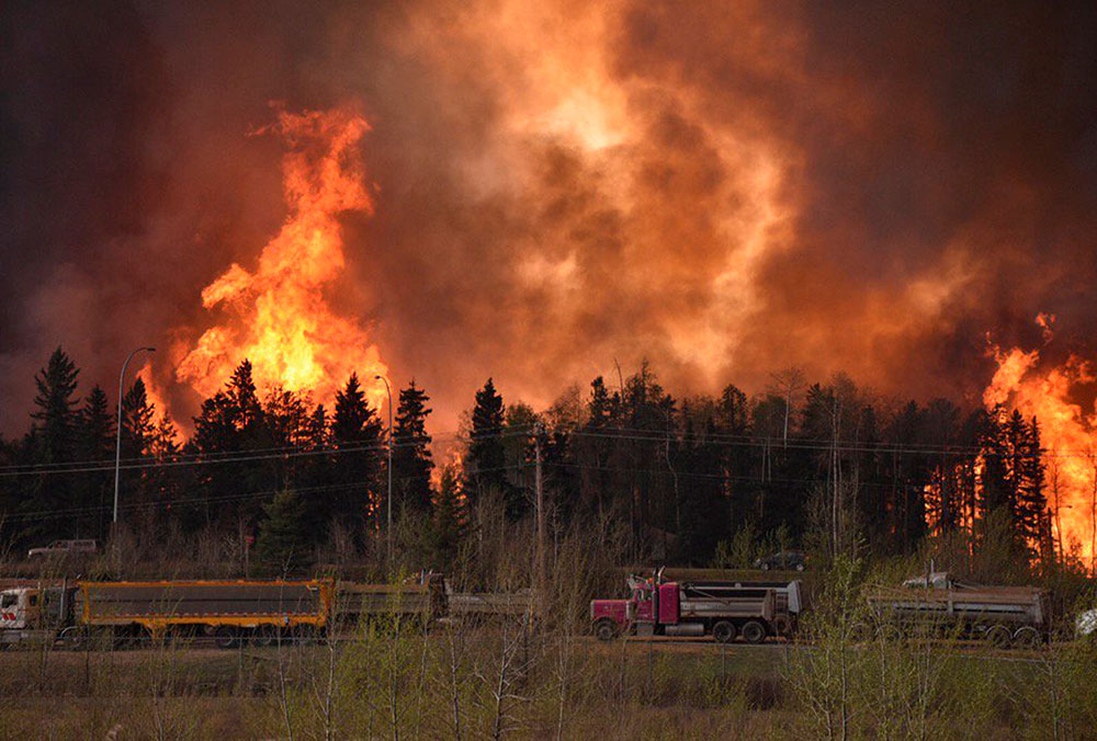 The raging wildfire emptied Canada's main oil city, destroying entire neighbourhoods of Fort McMurray, where officials warned Wednesday that all efforts to suppress the fire have failed. [Terry Reith/CBC News/Reuters]
