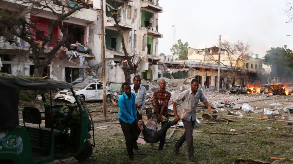 At least ten people killed in a suicide attack and gunfire targeting Ambassador Hotel in the capital of Somalia.
