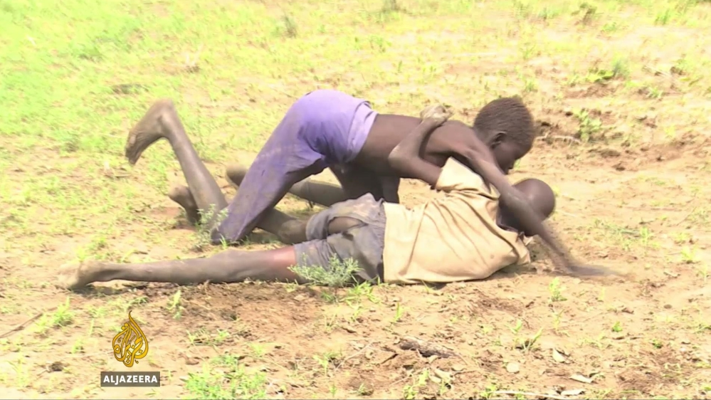 Young men demonstrate their strength to each other and potential cattle thieves in wrestling competitions.