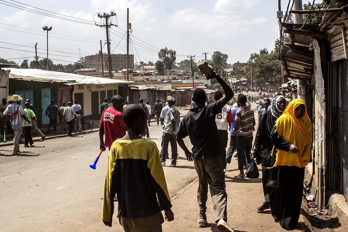 Protesters walk from Bombolulu towards Makina area near the Kibera slum in protest at Moses Kuria, an MP from Gatundu South constituency. [Natalia Jidovanu/Al Jazeera]