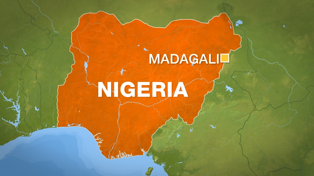 Gunmen on motorbikes attack village near Madagali in Adamawa state, killing mourners and setting houses on fire.