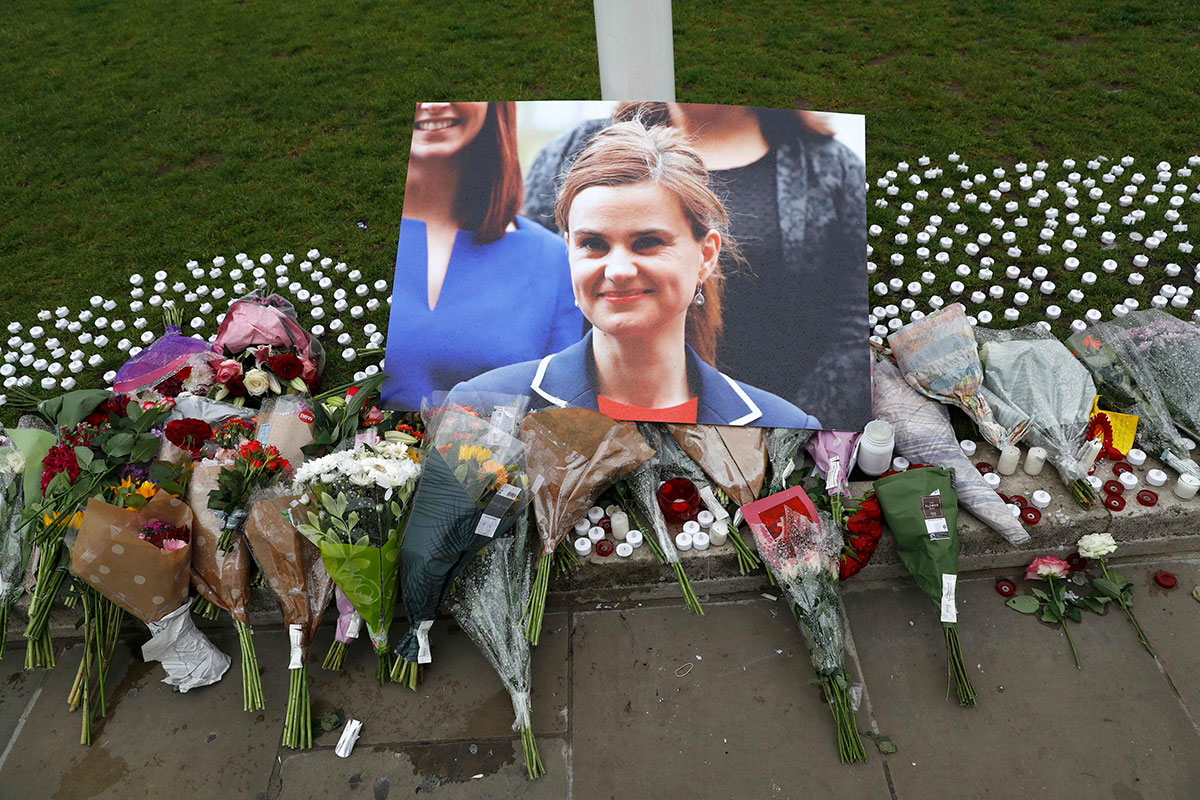 Tributes and candles left for murdered Labour Party MP Jo Cox are seen in Parliament Square, London, Great Britain. [Stefan Wermuth/Reuters]