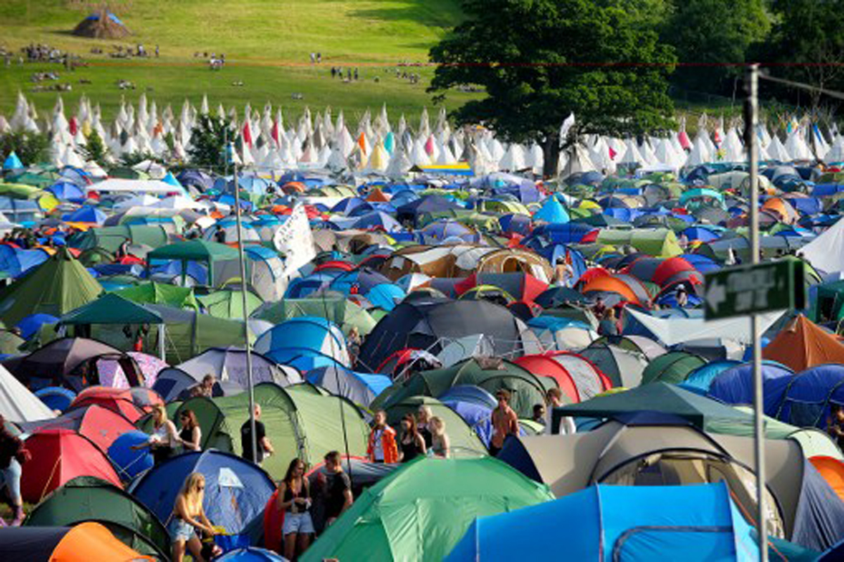 At Worthy Farm in Somerset's Glastonbury, a tented city has sprung up to house tens of thousands of festival-goers. [Andy Buchanan/AFP]